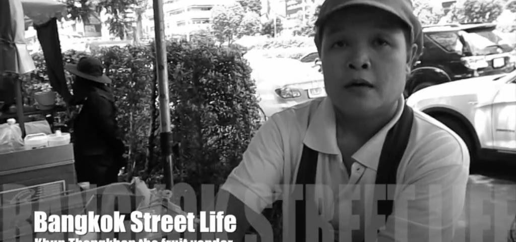 Street food vendor selling fruit in Bangkok